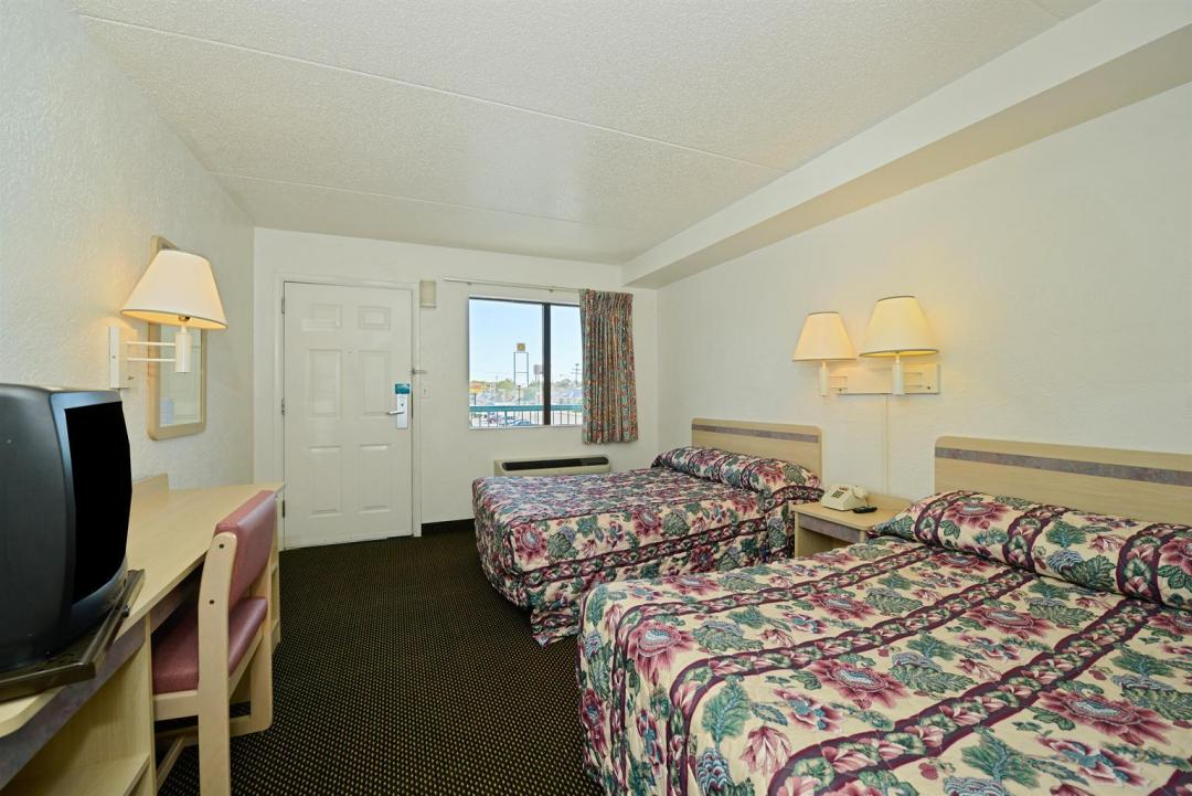 Two queen bed guest room with natural light