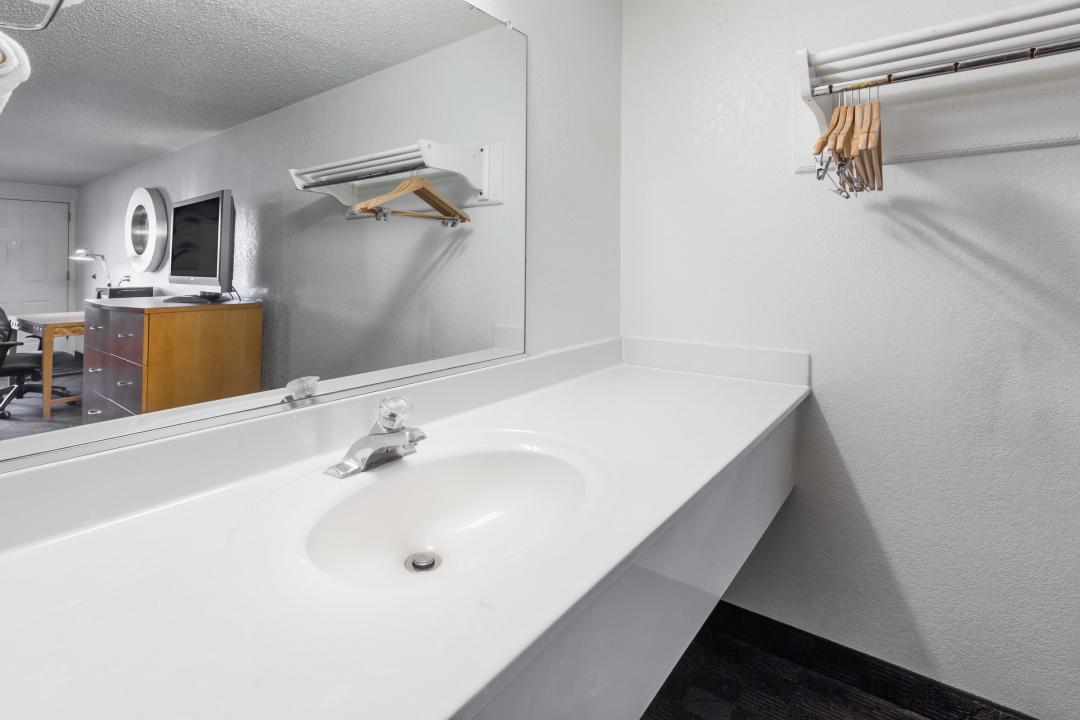 Clean well lit bathroom sink