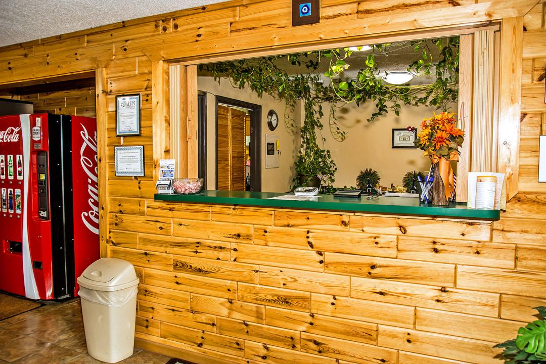 Front desk with wooden walls and vending
