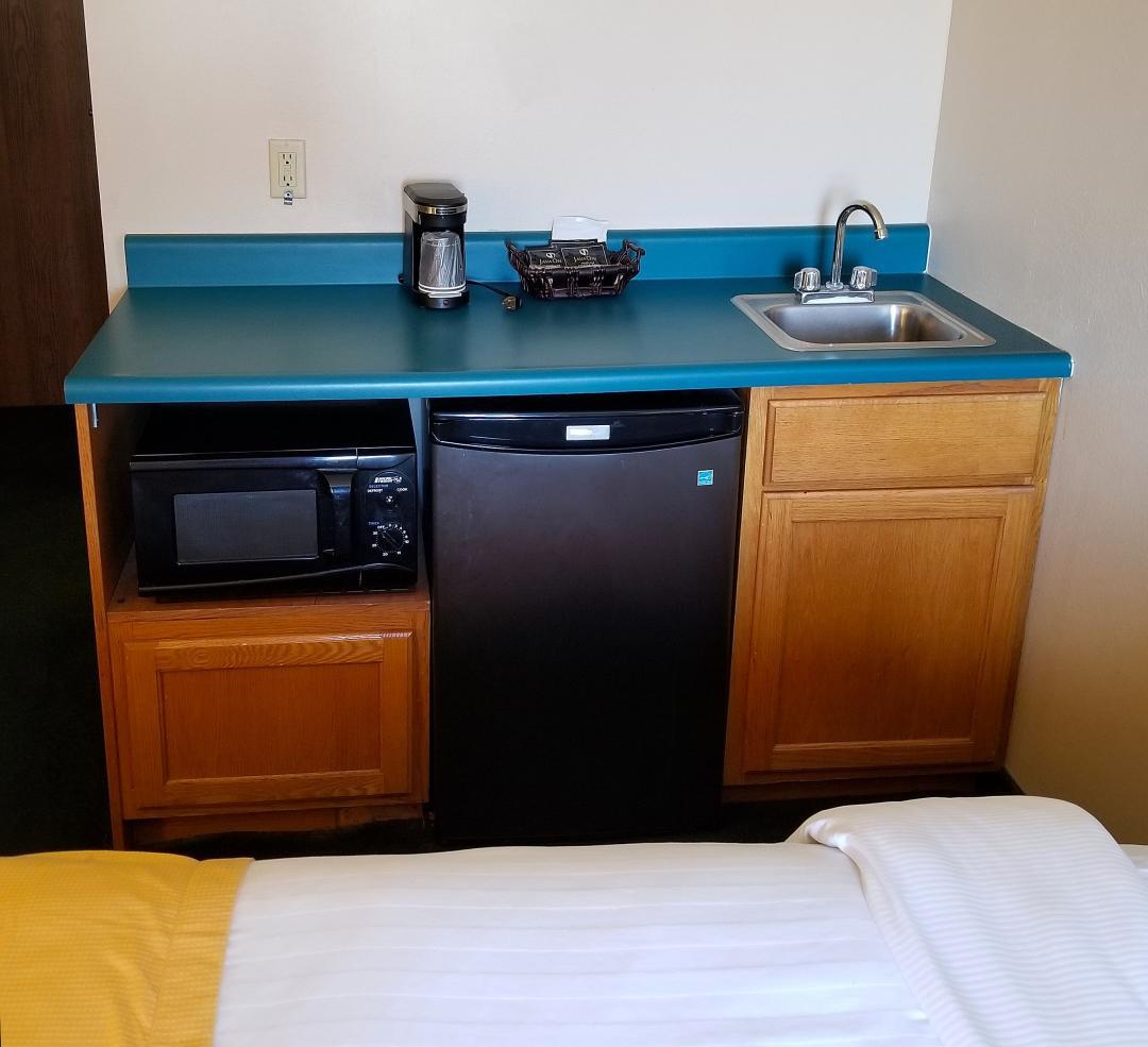 Deluxe guest room with queen bed