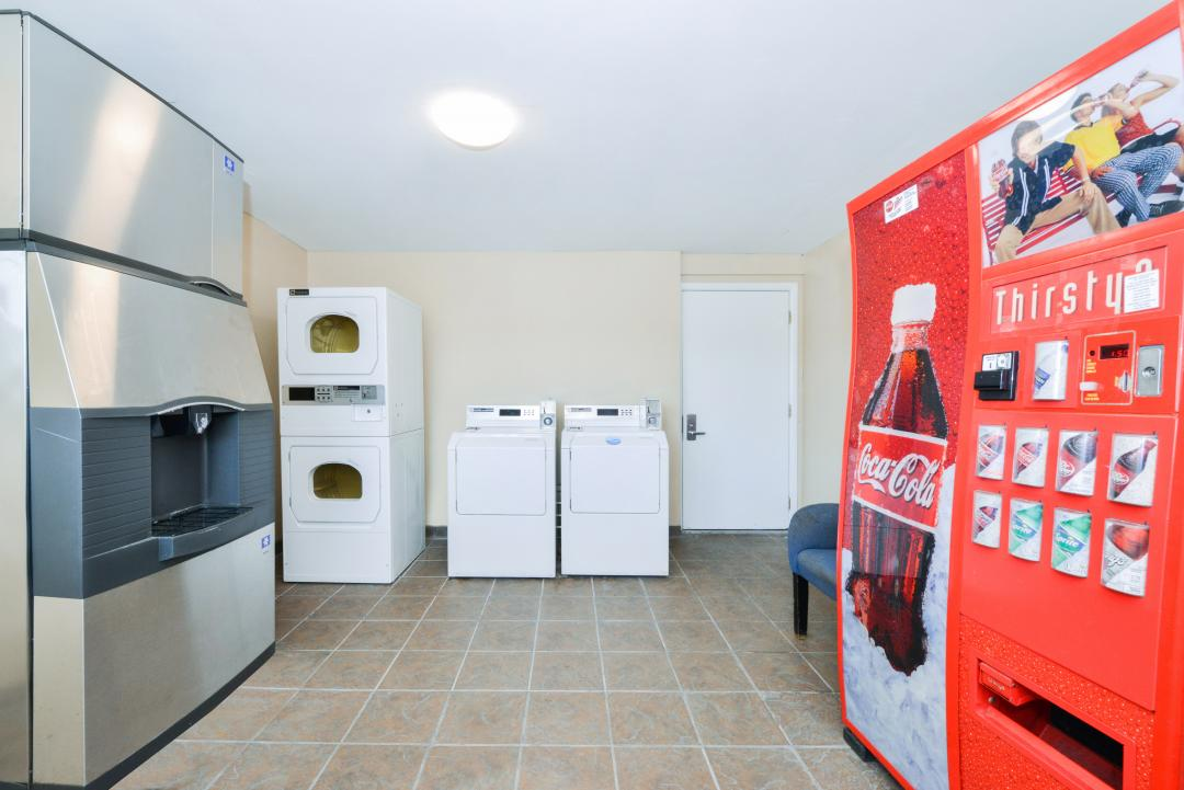 Guest laundry facility with coin-operated washer and dryer