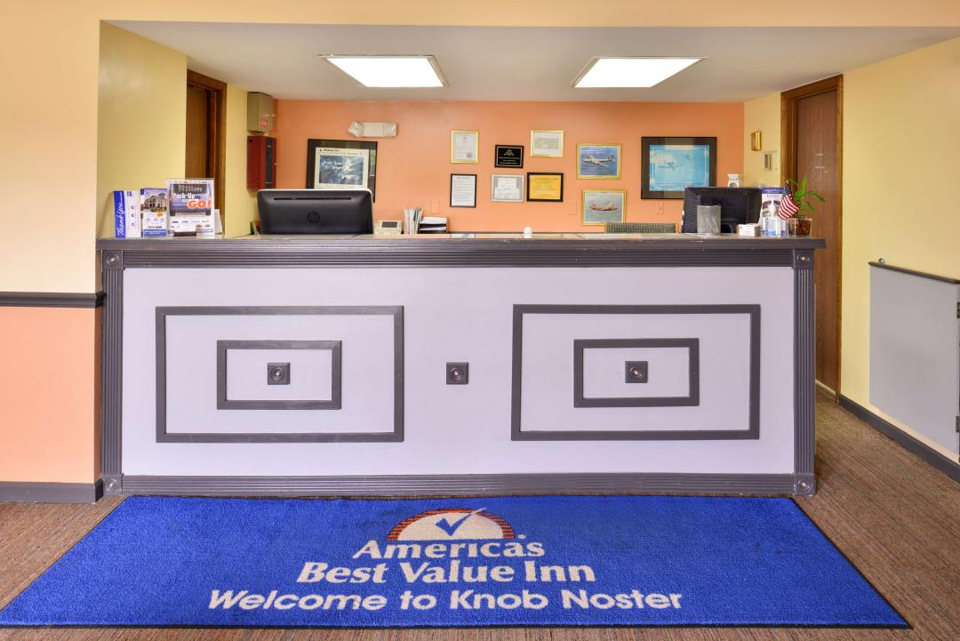 Hotel lobby with Front Desk and welcome mat