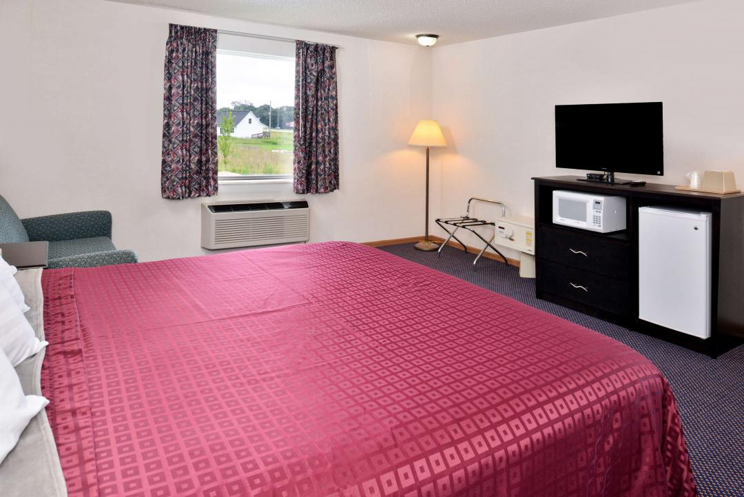 Guest Room with One King Bed and Flat panel TV with microwave and refigerator