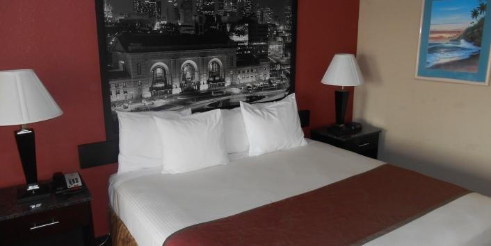 Spacious queen bedroom with two nightstands
