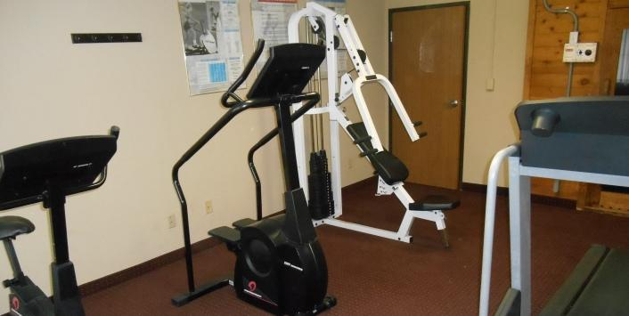 Fitness room with cardio and weight machines