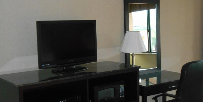 Guestroom flatscreen TV with microwave and desk