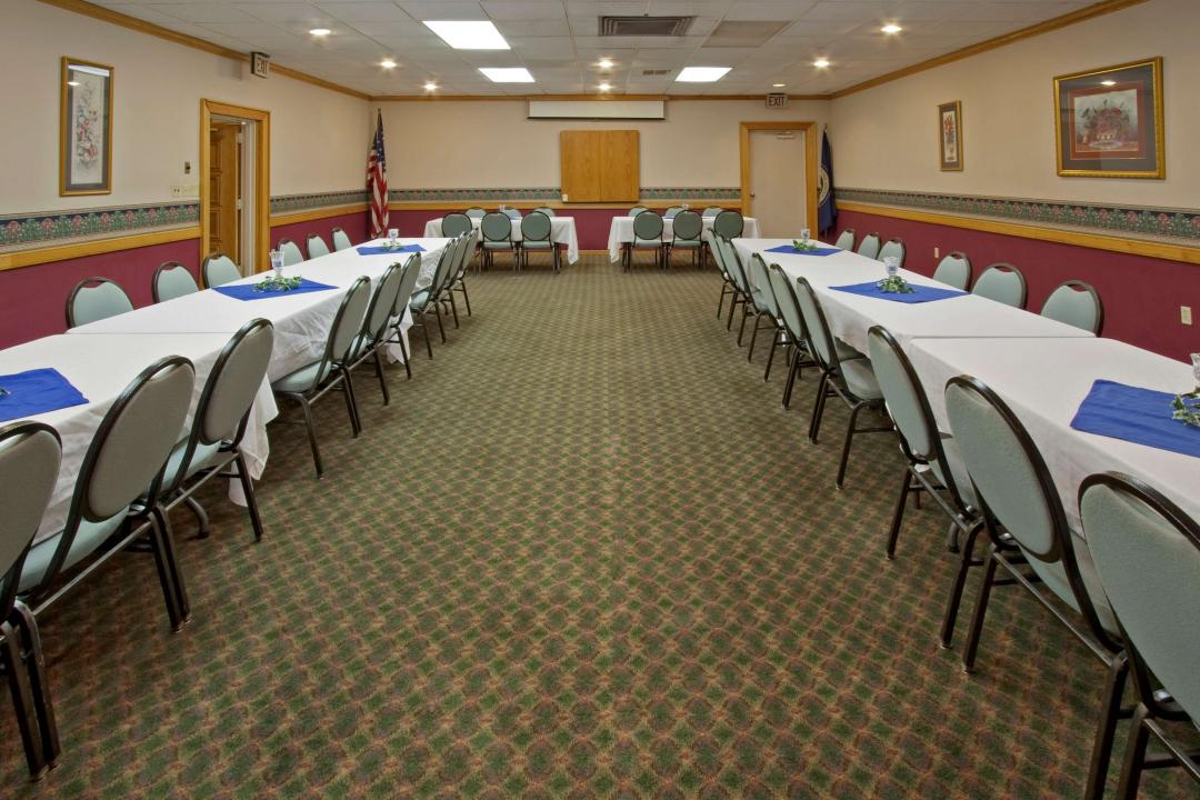 Meeting conference room with multiple tables and chairs