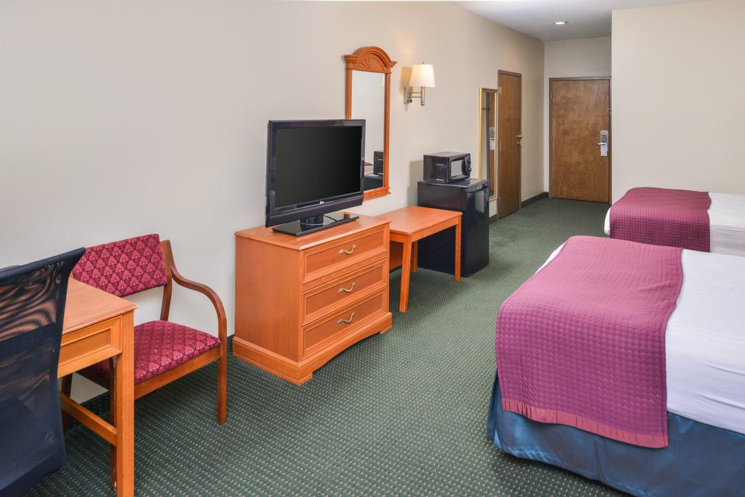 Spacious Suite with Two Queen Beds, a TV, Microwave, and Micro Fridge.
