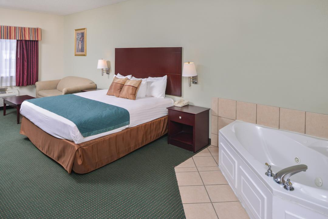 Spacious Jacuzzi Room with One King Bed and a Separate Sitting Area.