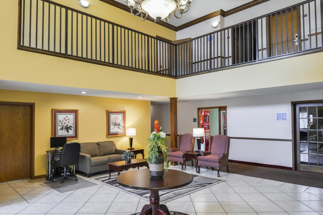 Hotel lobby with second floor railing above