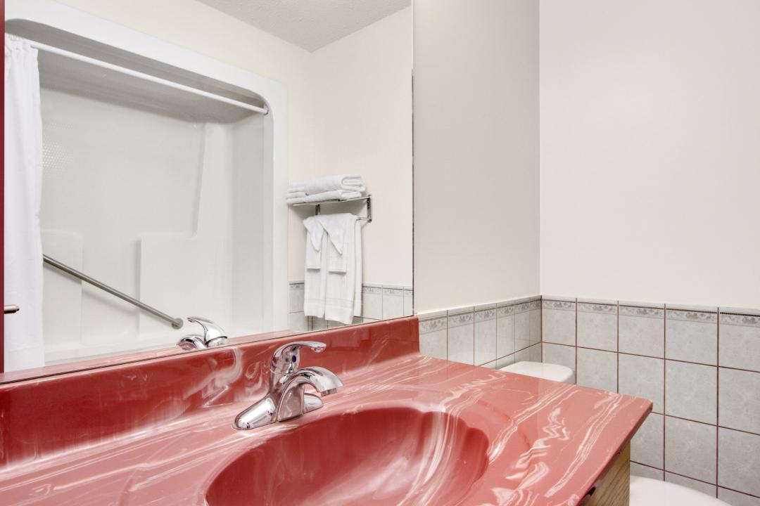 Clean, well lit guest room bathroom sink