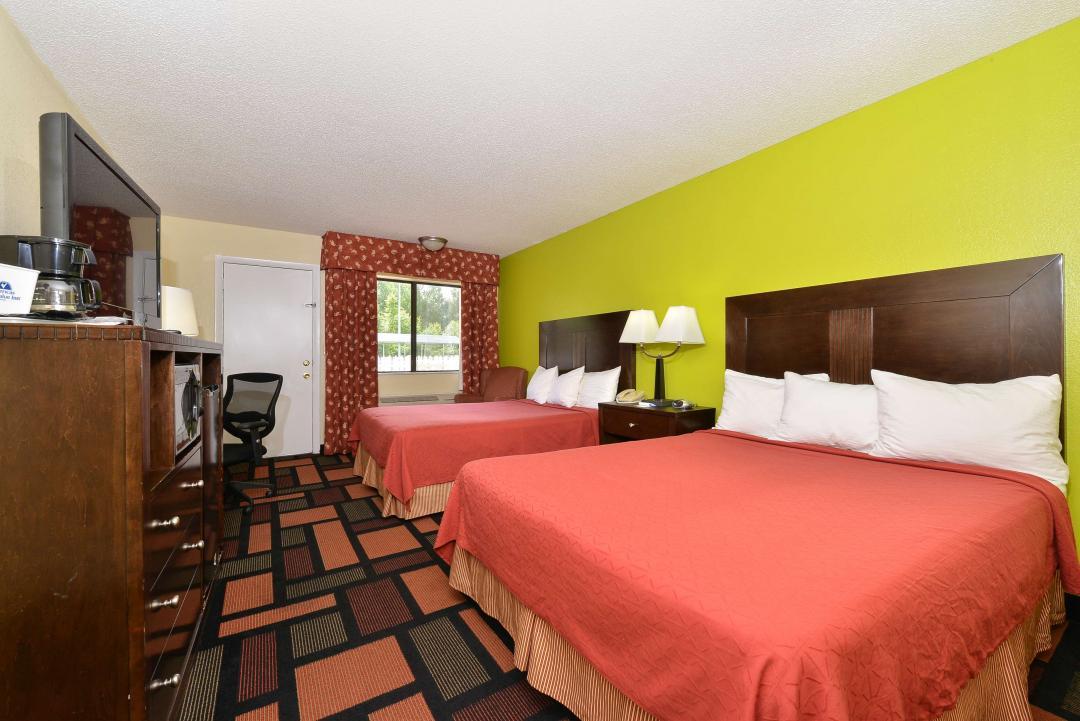 Two queen beds guestroom with window, TV, coffee machine, front door