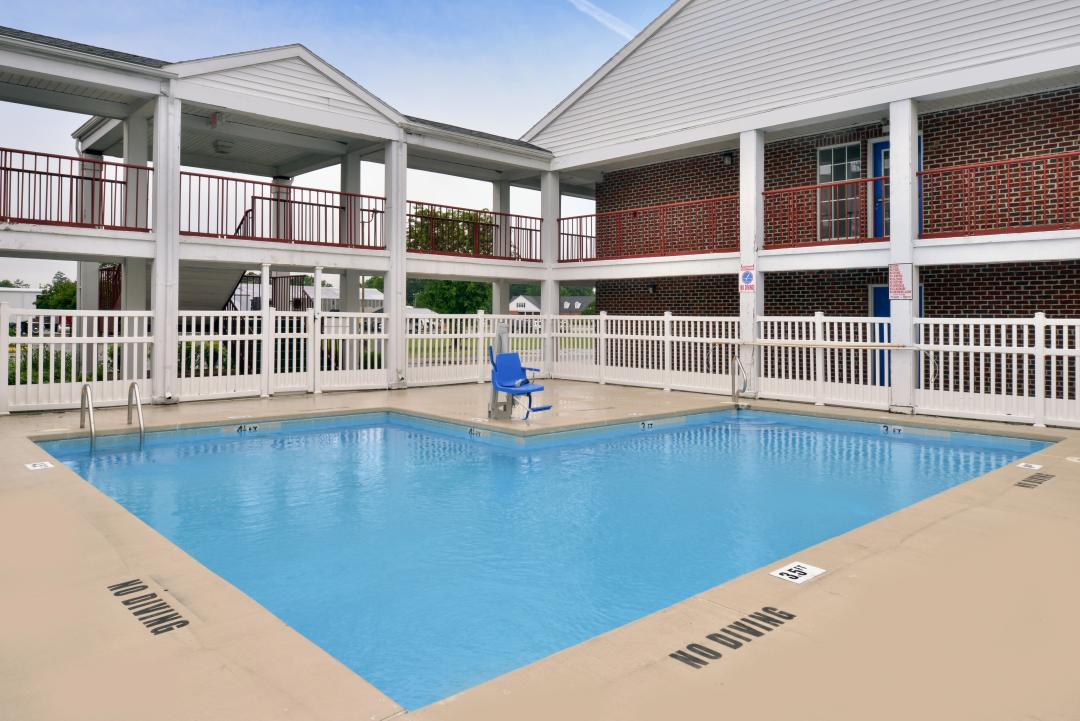 Outdoor pool with handicap accessible lift in hotel courtyard