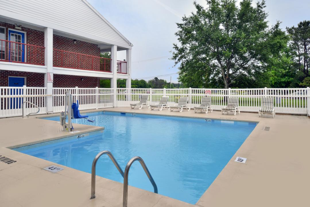 Outdoor pool with handicap accessible lift