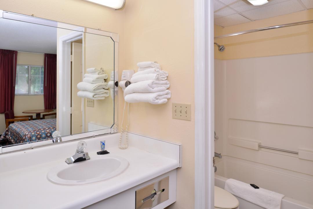 Open bathroom with blow dryer