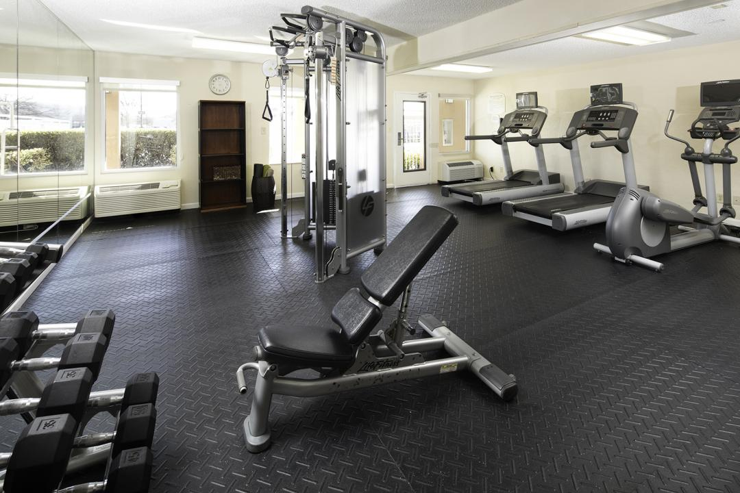 Fitness Room with Free Weights, Elyptical Machine, and Tread Mills