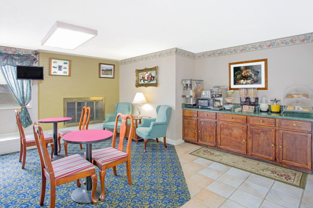 Complimentary breakfast in our spacious, well lit dining area with guest seating and TV.