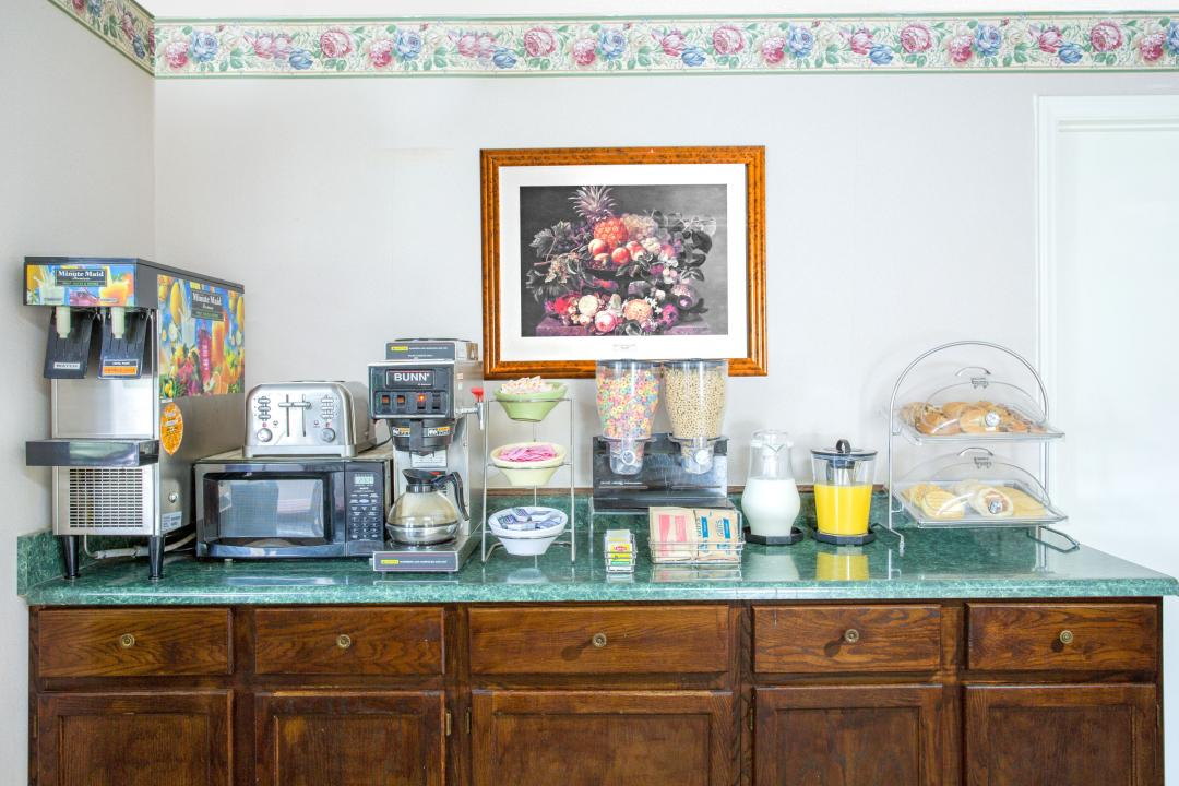 Breakfast bar featuring complimentary breakfast and drinks.