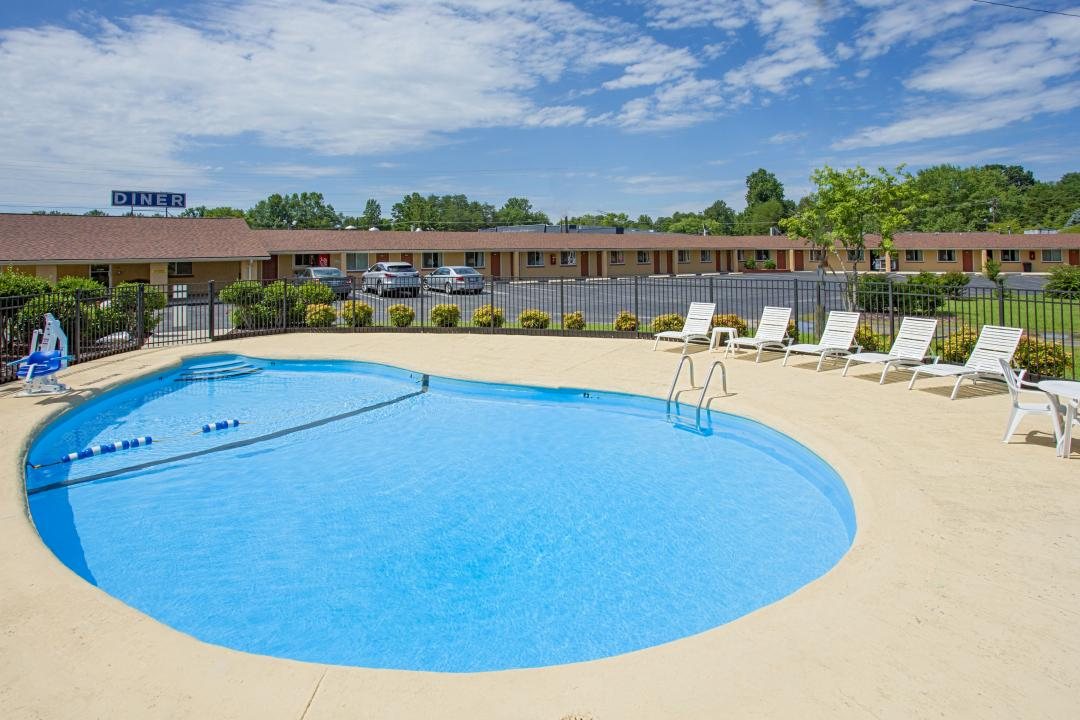 Cool off in our beautiful sparkling outdoor pool with  guest seating including an ADA pool lift.
