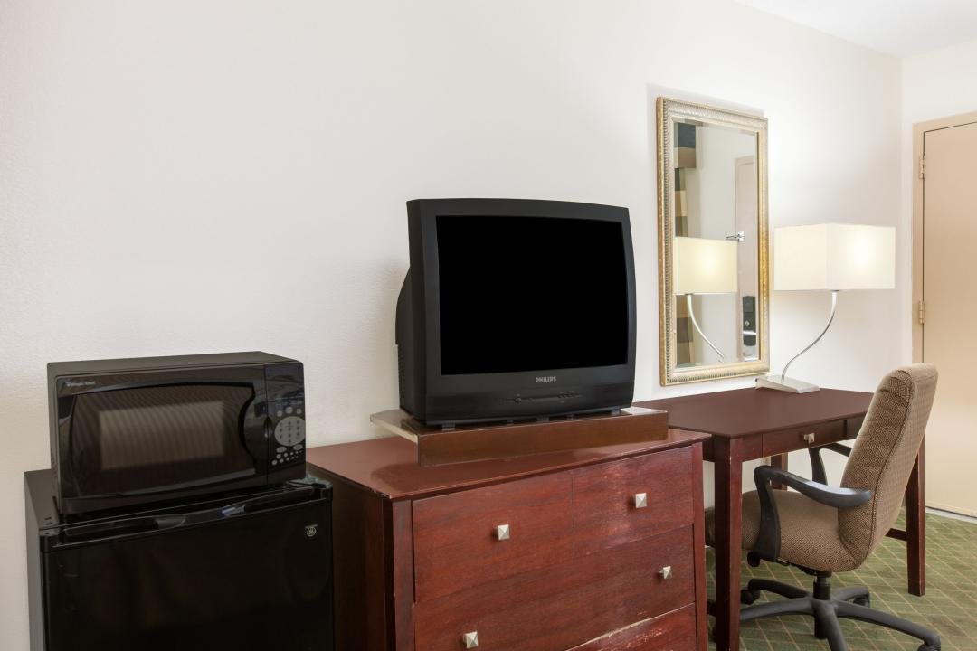Amenities include television, microwave, refrigerator and desk