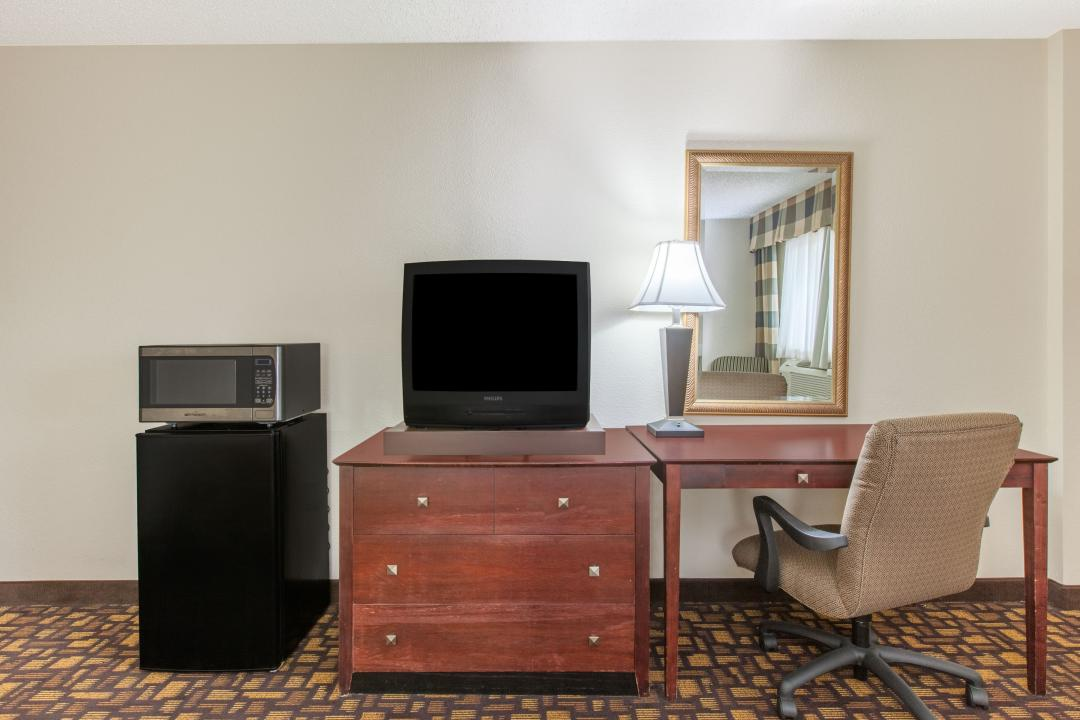 Guestroom amenities include television, microwave, refrigerator and desk