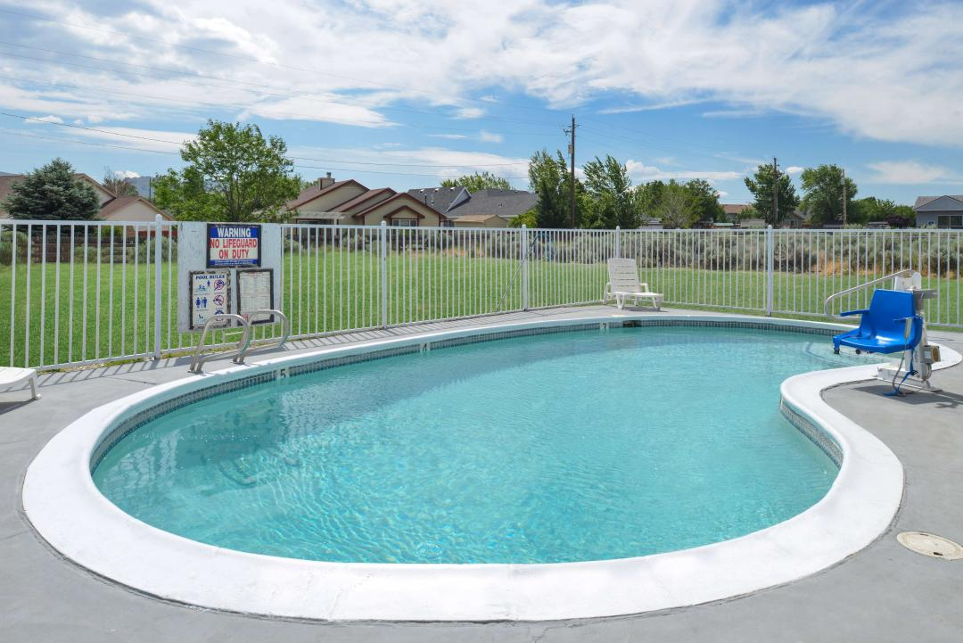 Fenced in pool with handicap lift