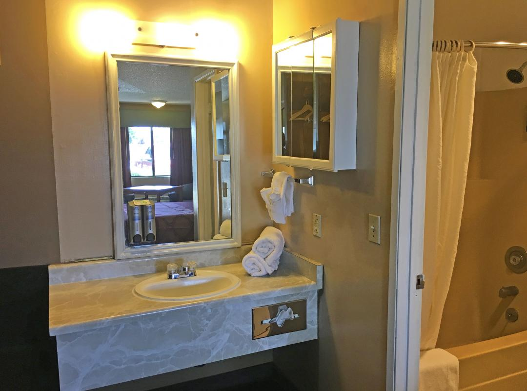 Vanity sink with towels and seperate bathroom