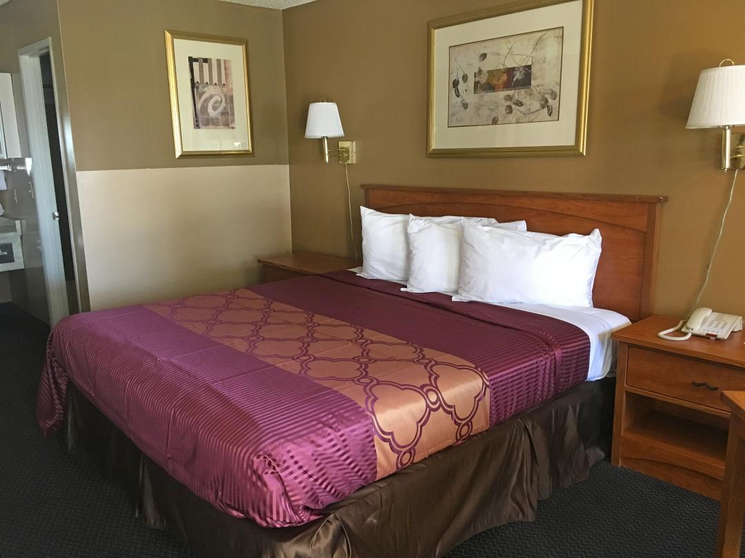 One Comfortable King Bed with night stands