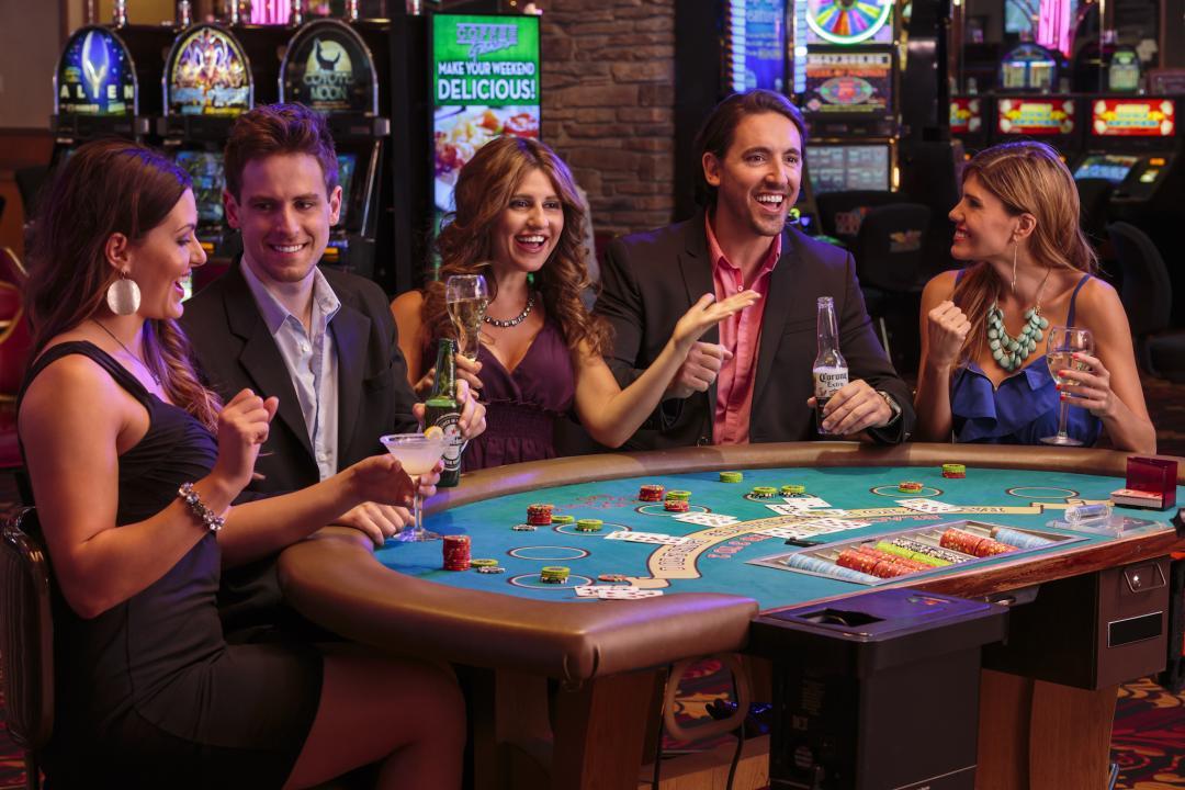 Group playing blackjack at casino