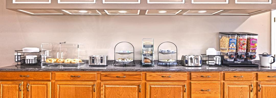 Breakfast counter with cereals, pastries, and toaster
