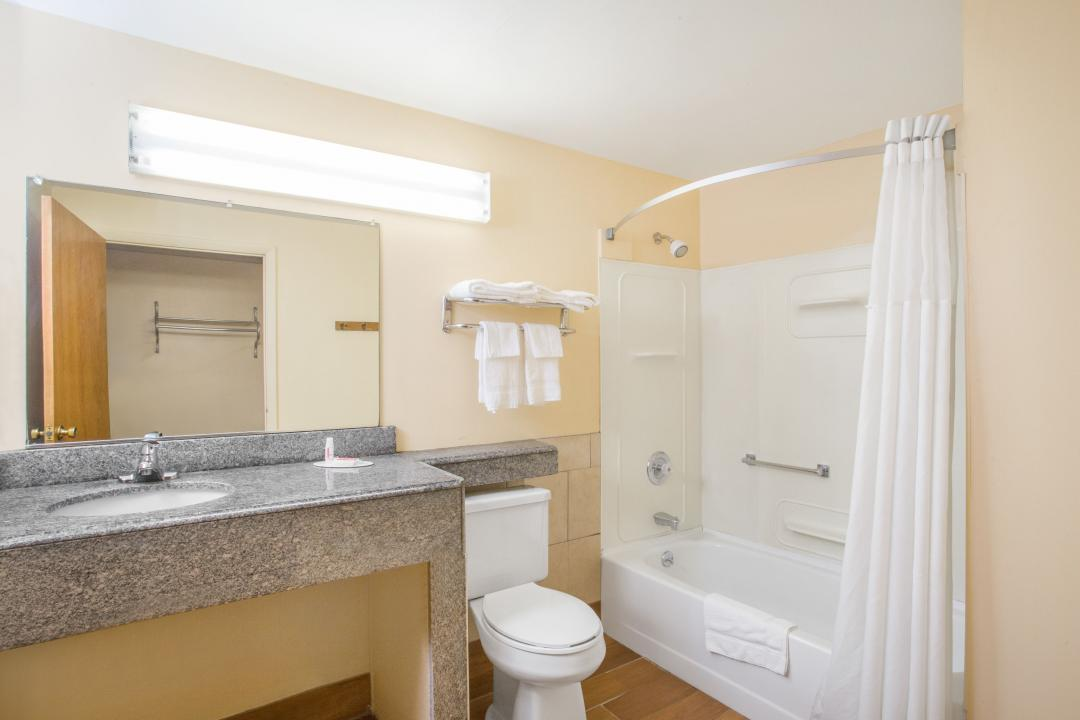 Clean and spacious guestroom showers