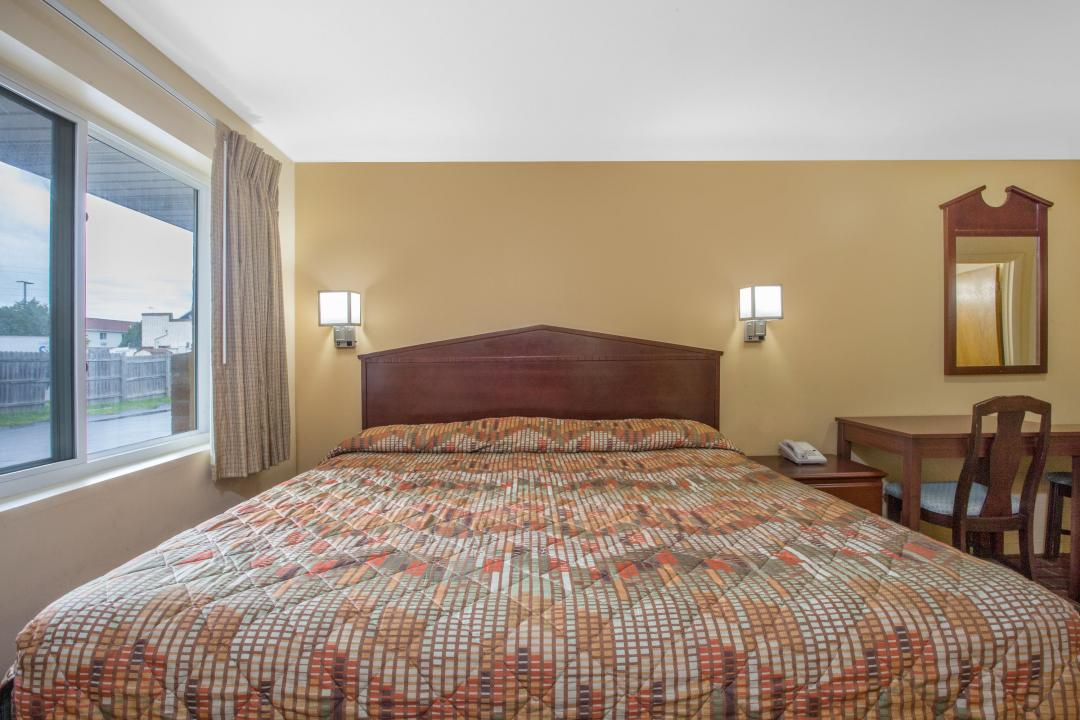 Single king bed guest room with direct access to outdoors