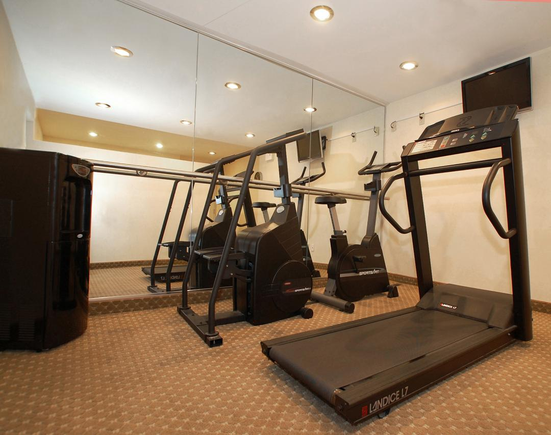 Fitness Room with Treadmill, Stair Climber, and Bike