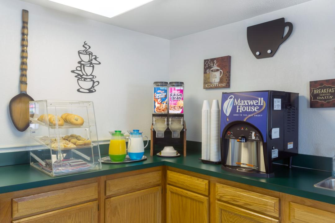 Breakfast area with cereal, coffee, juice, and breads
