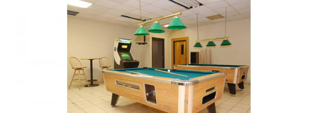 game room with billiard tables