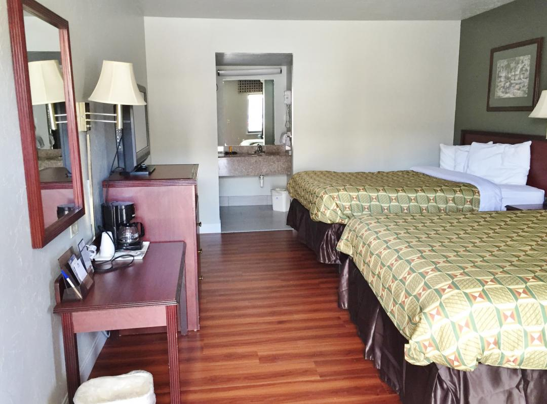Walk-in view oftwo queen guest room
