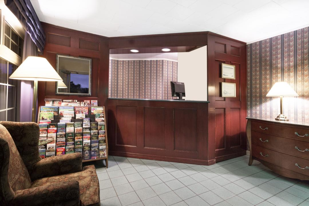 Hotel lobby with front desk and guest seating
