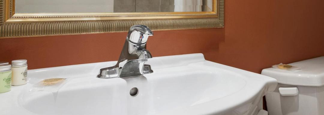 Guest room sink with bath amenities