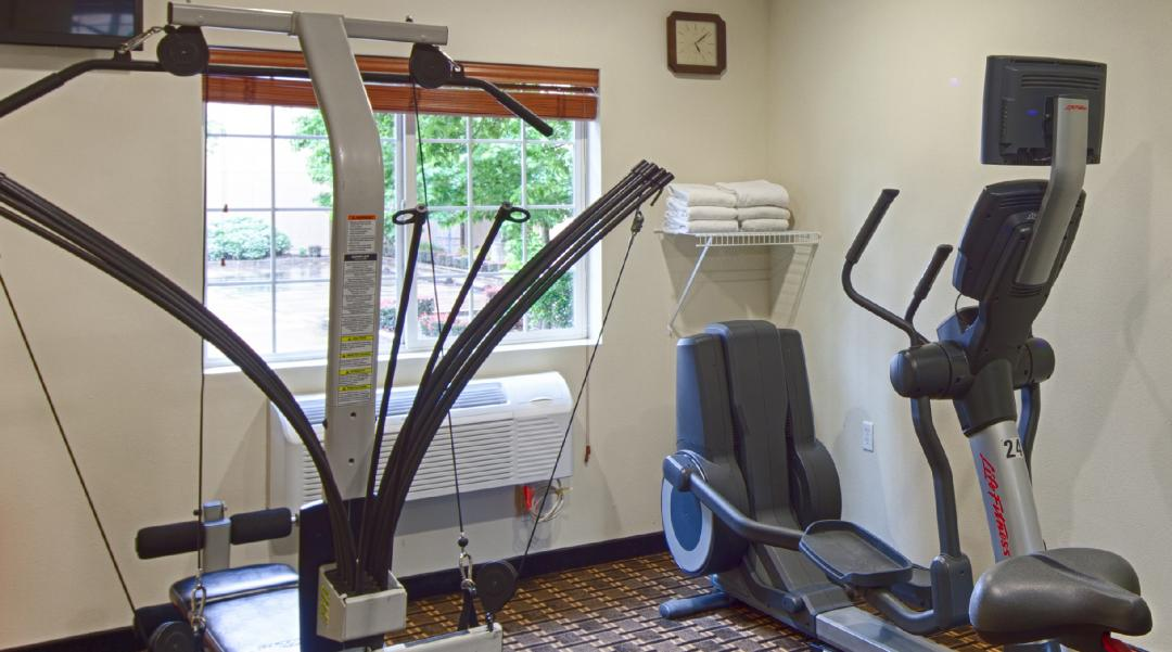 Fitness Center with elliptical machine and soloflex