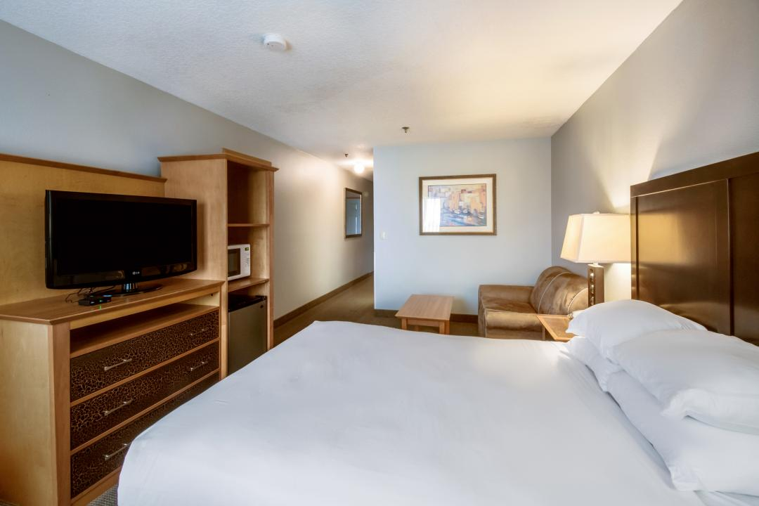 Hotel guest room with king bed