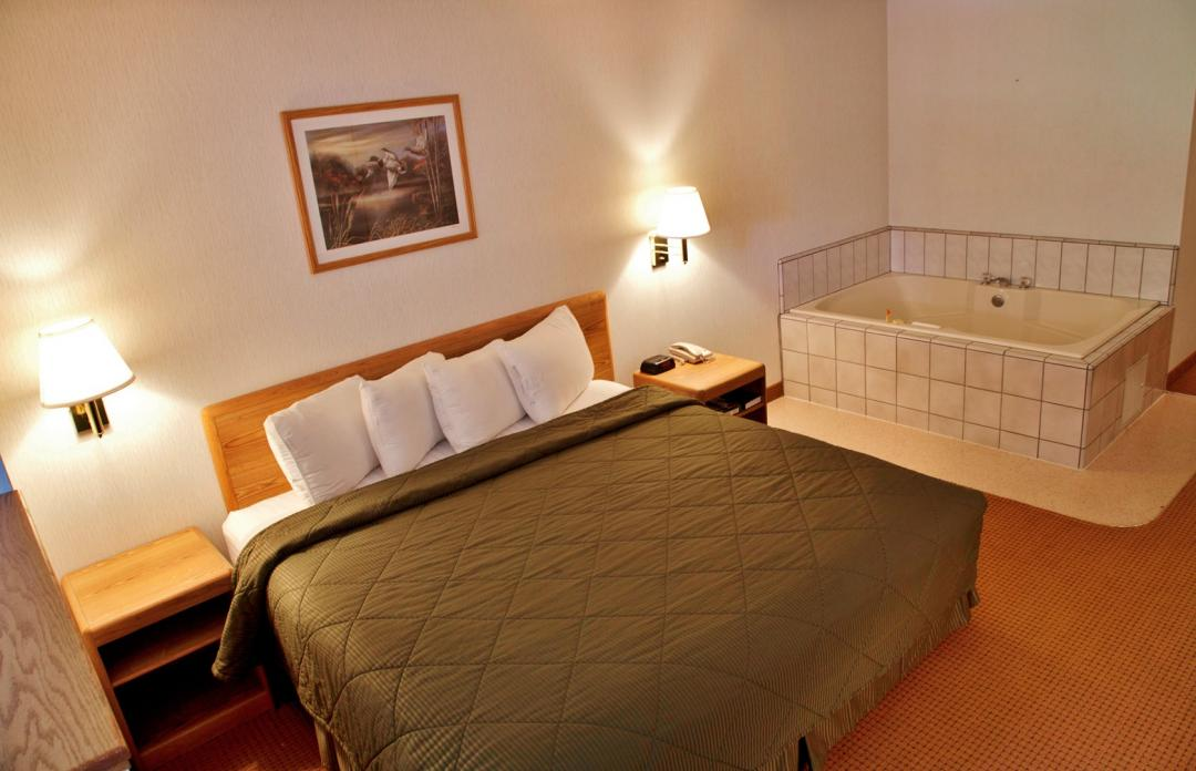 Guest room with king bed and in room Jacuzzi