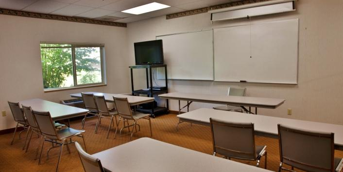 Meeting room with two white boards