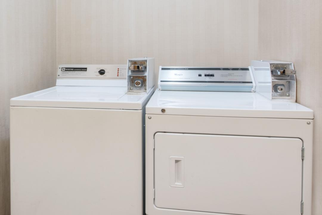 Guest laundry facility includes coin-operated washer and dryer