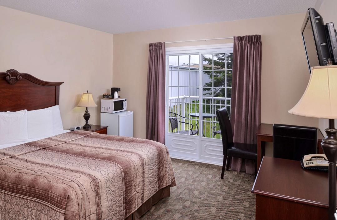 One Queen Bed Balcony Deluxe