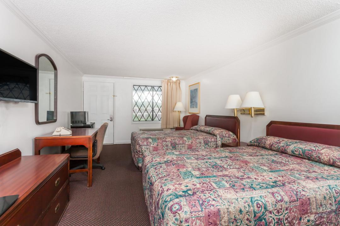 Spacious two queen guest room with desk, chair, TV, microwave and refridgerator