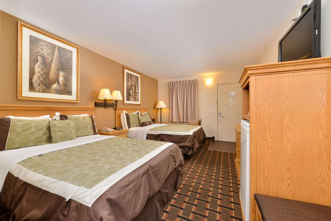 Spacious clean two queen guestroom and amnities