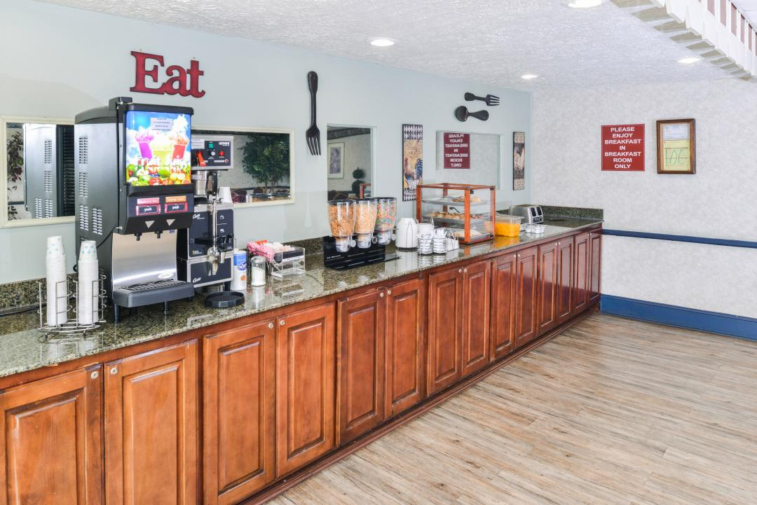 Breakfast Area Bar with Coffee Service, juice, pastries, and Cereal.
