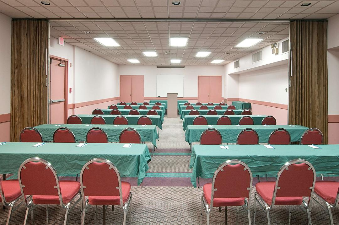 Conference center with multiple long tables and chairs