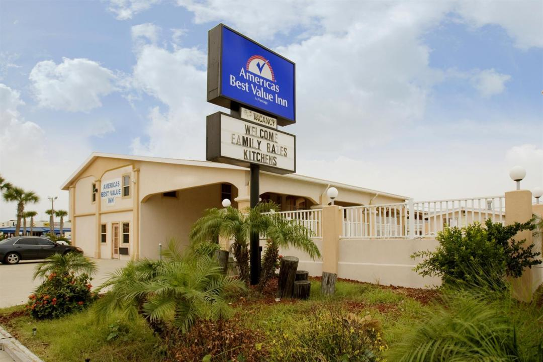 Street view of hotel exterior with sign