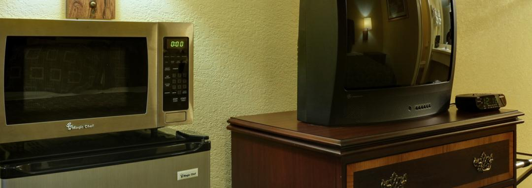 Guest Room Amenities Including Microwave, Mini Fridge, and TV